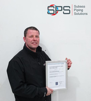 Steven Mitchell with ISO 9001 and ISO 14001 certificate.